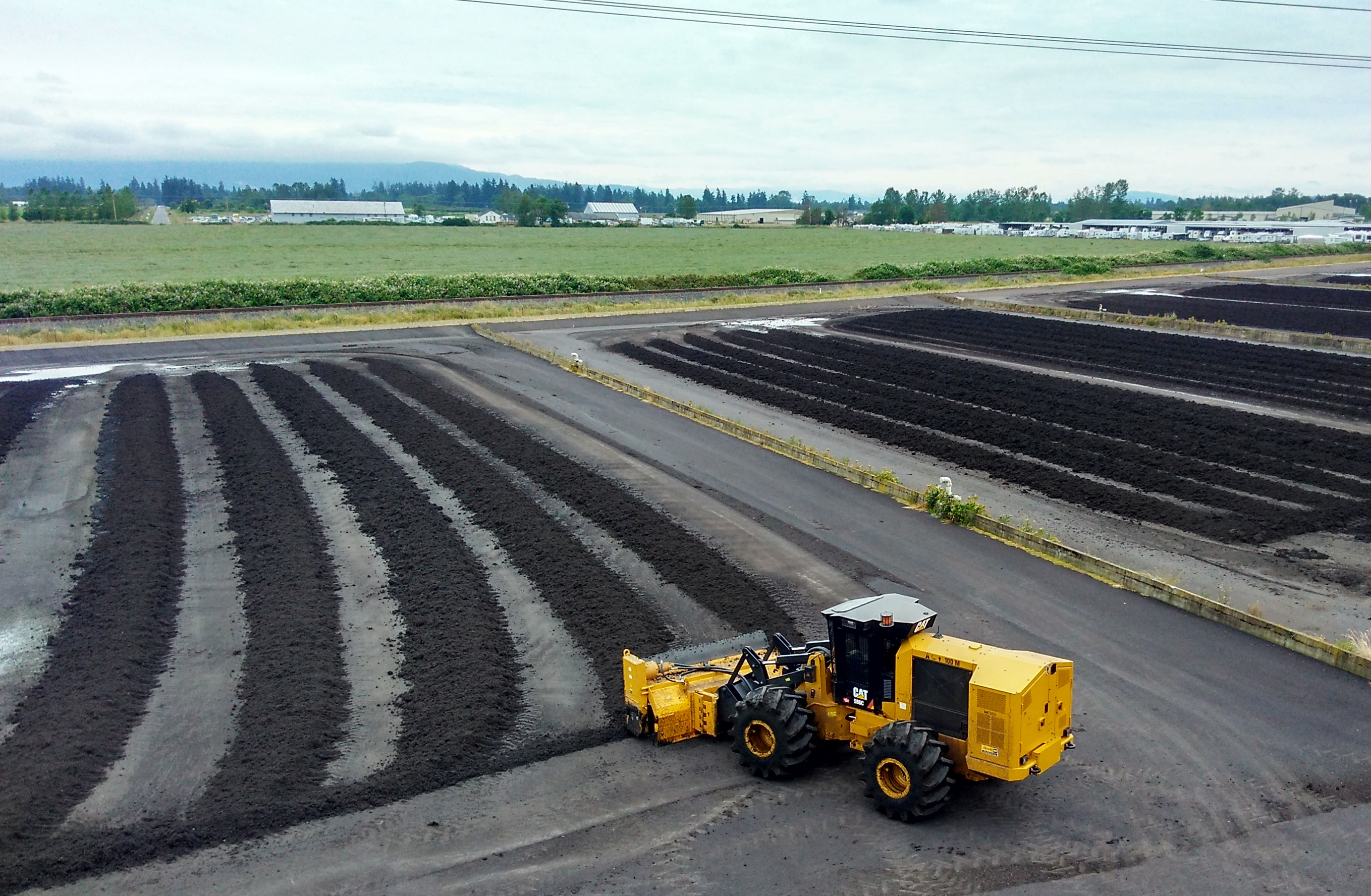Turning over biosolids for additional drying